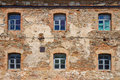 Old orange brick wall with six windows Royalty Free Stock Photography