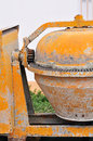 Old orange portable concrete mixer Stock Photo
