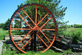 Old Orange Water Wheel Stock Image