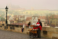 Old organ grinder on the Charles Bridge Stock Image