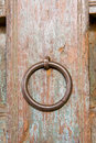 Old ornamental door circular door handle Stock Photo
