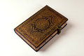 Old ornate notebook leather stamped cover Stock Photo