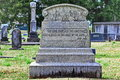 Old ornate tombstone book of job verse granite with Stock Images