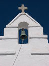 Old orthodox church bell in mykonos greece antique at the white facade Stock Photos