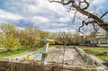 Old outdor pool abandoned ruined outdoor swimming with grafitti on the walls and a blue sky with clouds Royalty Free Stock Photo