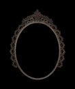 Old oval picture frame metal worked on black background Royalty Free Stock Photo