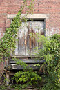 Old overgrown loading dock Stock Photo