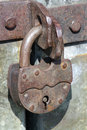 Old pad lock rusted steel door and Royalty Free Stock Photo