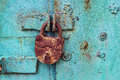 Old padlock on a blue door Royalty Free Stock Photo