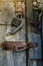 Old padlock with chain on wooden gate Stock Images