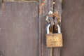 Old padlock close up photo rusty on a iron door Royalty Free Stock Images