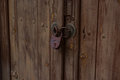 Old padlock at one wooden door Royalty Free Stock Photo