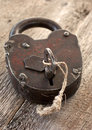 Old padlocked on a wooden background Stock Images