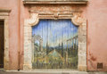 Old paint on wood door village roussillon ochres france artisticly painted wooden gate in provance Stock Photo