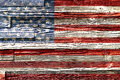 Old painted american flag on dark wooden fence Stock Photography