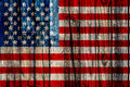 Old painted american flag on dark wooden fence Royalty Free Stock Photography