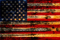 Old painted american flag on dark wooden fence Stock Photos