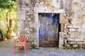 Old painted blue door on the ancient stone wall, Greece