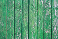 Old painted fence fragment of an in green wooden Royalty Free Stock Image