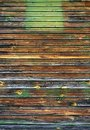 Old painted peeled off dark brown wood planks texture background backdrop Royalty Free Stock Photo