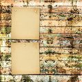 Old painted wooden plank with paper card Royalty Free Stock Photo