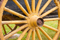 Old painted yellow wagon wheel on historic cart Royalty Free Stock Images