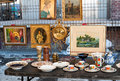 Old paintings and other stuff for sale in a flea market Royalty Free Stock Photography
