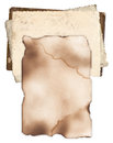 Old paper with burned edges on bunch of vintage photos damaged and isolated Royalty Free Stock Images