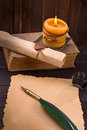 Old paper candle and quill pen Royalty Free Stock Photo