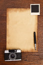 Old paper, ink pen and vintage photo frame with camera Royalty Free Stock Photo