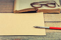 Old paper, pen, book and glasses Royalty Free Stock Photo