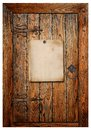 Old paper poster in the wooden door Stock Images