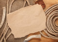 Old paper and rope on wooden textured background for copy space Stock Images