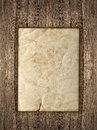 Old paper sheet over rustic wooden background Royalty Free Stock Photo