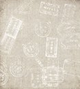 Old paper travel background with different passport stamps Royalty Free Stock Photo
