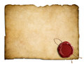 Old parchment paper or letter with red wax seal Royalty Free Stock Photo