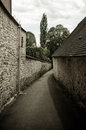 Old path between stone houses Royalty Free Stock Photos