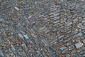 Old pavement from colored stones. Abstract background or texture