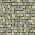 Old Paving Stones with moss and turf. Road Texture seamless pattern. wall of stone, cobbled street with grass Royalty Free Stock Photo