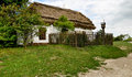 Old peasant house with thatched roof Stock Photos