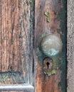 Old peeling, wood door with old metal door knob Royalty Free Stock Photo