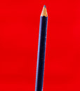 Old pencil red background Royalty Free Stock Photo