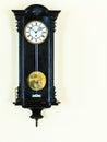 Old pendulum clock on wall big wooden hanging Royalty Free Stock Photos