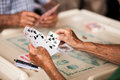 Old people playing cards a group of elderly card Stock Image