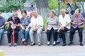 Old peoples the are sitting in children park in taiyuan shanxi china Royalty Free Stock Images