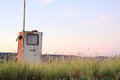 Old petrol pump next to the road Royalty Free Stock Photography