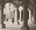 Old photo from a building style an s quad and patio stone pillars and arch oldstyle Royalty Free Stock Photo