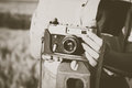 Old photo camera in a hands of girls. Royalty Free Stock Photo