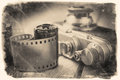 Old photo film roll and retro camera on desk. Royalty Free Stock Photo