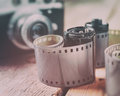 Old photo film rolls, cassette and retro camera Royalty Free Stock Photo